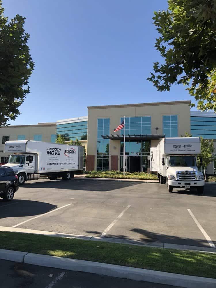 Smooth-Move-USA-two-trucks-in-front-of-office