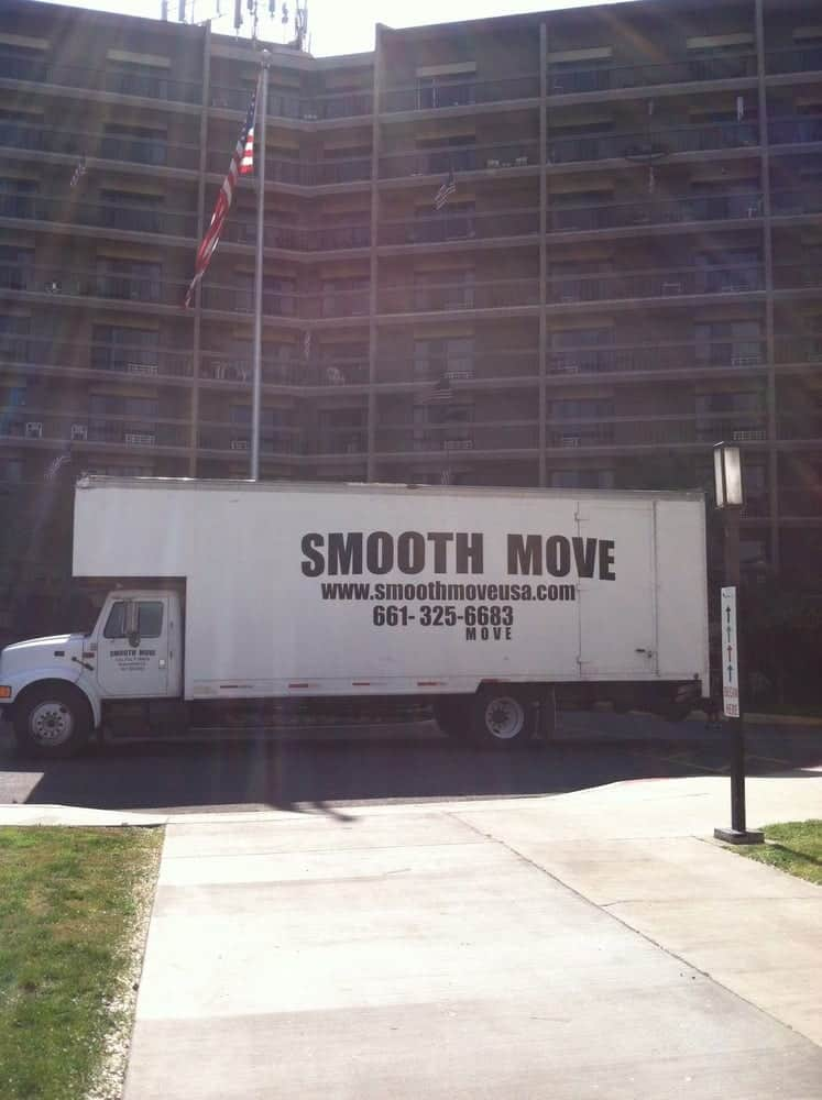 Smooth Move truck in front of big building