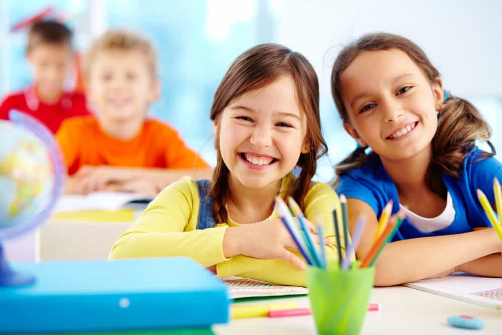 Happy elementary students at school.