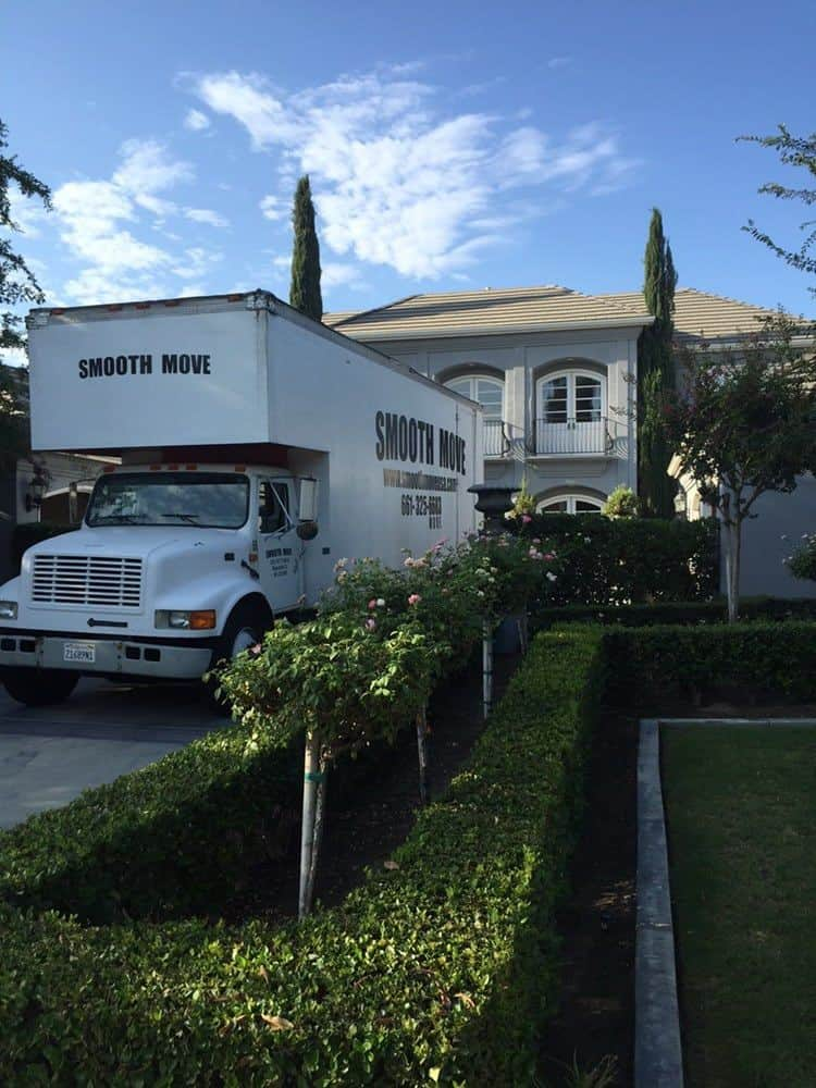 Smooth Move USA truck in front of residential home